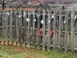 New! Snowflake icicle & JOY lights bedecking the fence.